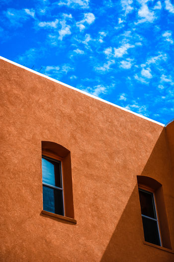 Windows of the world Building Exterior Architecture Built Structure Window Blue Low Angle View Sky Building No People Cloud - Sky Day Nature Residential District Wall - Building Feature Sunlight Outdoors House Brown Orange Color Reflection Design Modern