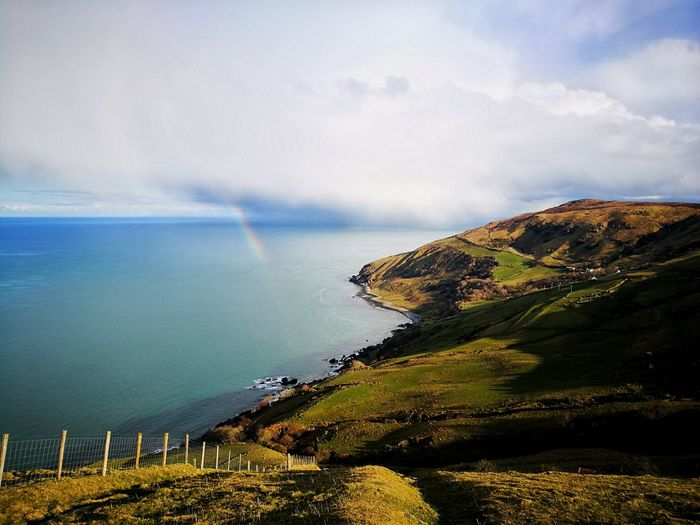 Mini Rainbow Rainbow Coastline Cloud - Sky Clouds And Sky Agricultural Land Northern Ireland Ireland Irish Landscape Nature Nature_collection Nature Photography Naturelovers EyeEm Best Shots EyeEm Nature Lover EyeEm Best Shots - Nature Water Sea Cliff Sky Landscape Cloud - Sky