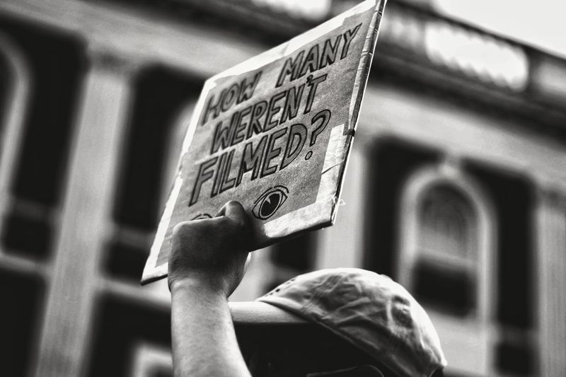 Low-view angle of person holding protest sign