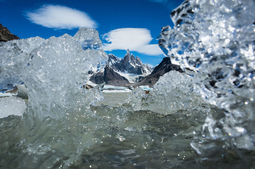 Cerro Torre between Ice in Lago Cerro Torre Cerro Torre Argentina Beauty In Nature Cloud - Sky Cold Temperature Day Flowing Water Fritz Roy Frozen Ice Iceberg Melting Motion Mountain Nature No People Outdoors Scenics - Nature Sea Sky Snow Splashing Water Waterfront Winter