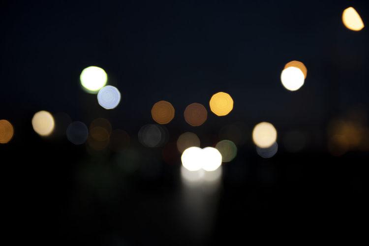 Night Illuminated Defocused Circle Geometric Shape Lighting Equipment Glowing Shape No People Light - Natural Phenomenon Light City Street Lens Flare Outdoors Electric Light Street Light Architecture Dark Pattern Nightlife Bokeh Bokehlicious Bokeh Lights