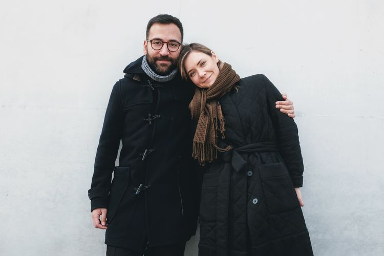 Adult Arm Around Bonding Clothing Couple - Relationship Front View Looking At Camera Men Portrait Positive Emotion Scarf Smiling Standing Three Quarter Length Togetherness Two People Warm Clothing Winter Women Young Adult Young Men Young Women