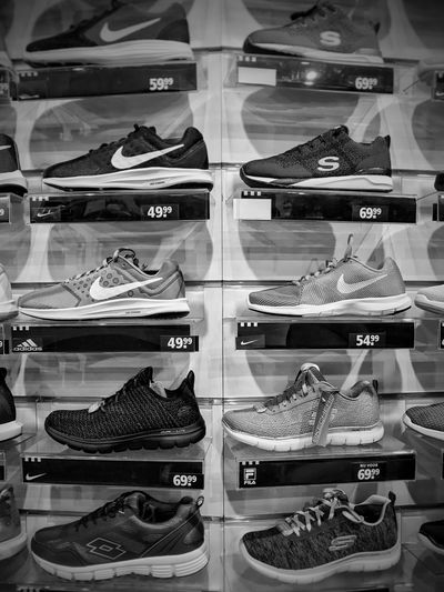 Sport shoes and sneakers in the store Fashion Store Shoe Clothing Store Variation For Sale Clothing Large Group Of Objects Modern Buying Business Clothes Fashion Footwear Monochrome New Prices Sale Shoe Store Shoes Shoes Fashion Sneakers Store Style Editorial
