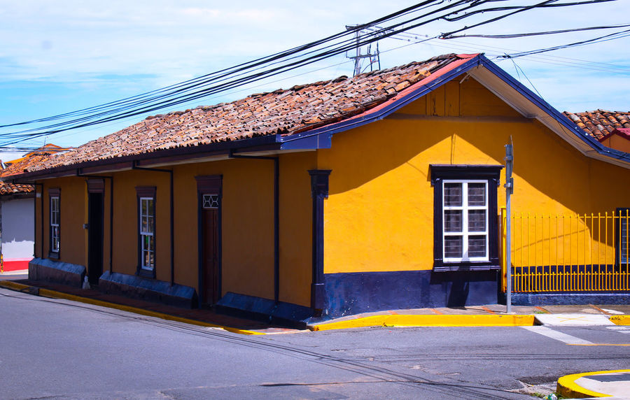 house House Color Costa Rica Barva Heredia, Costa Rica Walking Around Taking Pictures Walking Around Outdoors Streetphotography Sky Architecture Building Exterior Built Structure Residential District Tiled Roof  Country House