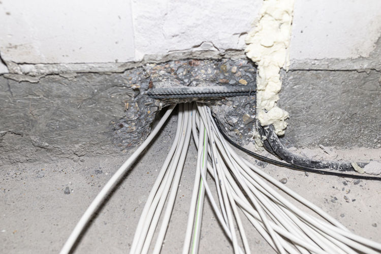 Layed installation of electric cables on the floor in a newly built house. cables passing through