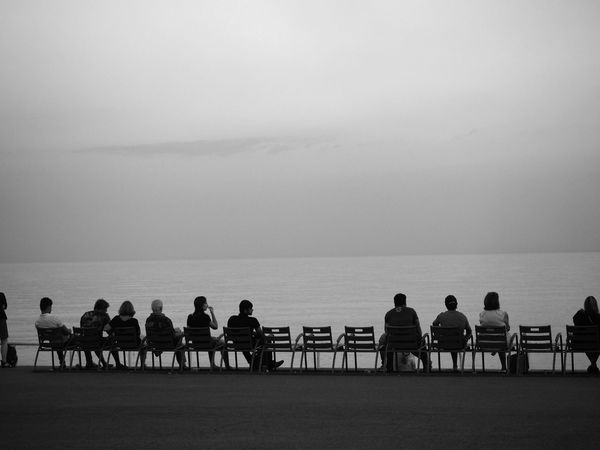 Beach Blackandwhite Photography Evening Atmosphere Horizon Over Water People On Chairs People Watching Sea Silhouette Sitting Togetherness Waterfront Waterfront Promenade
