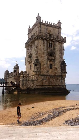 Belem tower Architecture Building Exterior Travel Destinations Travel Built Structure History Vacations Lifestyles Outdoors Tourist Real People Lisbon Portugal
