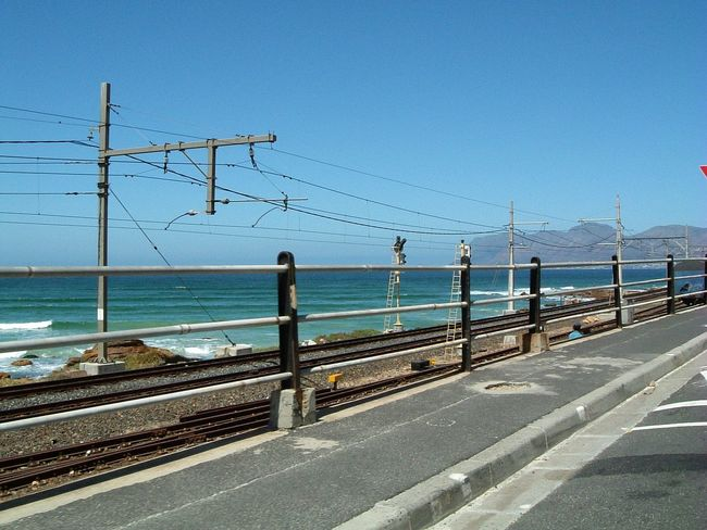 Travelling Along The Railway Track ~ Beauty In Nature Blue Cable Clear Sky Coastline Day False Bay Horizon Over Water Live For The Story Nature No People Outdoors Railing Railway Track Scenics Sea Sky South Africa St. James The Great Outdoors - 2017 EyeEm Awards The Street Photographer - 2017 EyeEm Awards Tranquil Scene Transportation Water