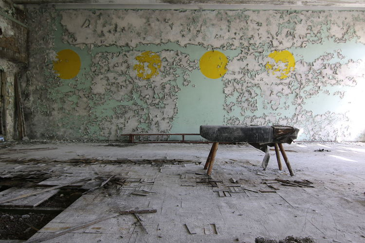 Table in room of abandoned building