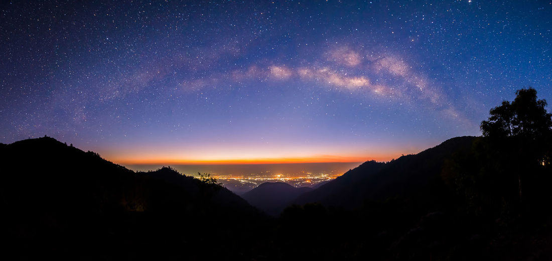 Panoramic Milky way at Doi Ang Khang , Chiang Mai , Thailand , Low Light , High ISO ASIA Atmosphere Beautiful Camping Chiangmai Galaxy Light Morning Nature Panorama Silhouette Thailand Travel Twilight View Astronomy Backgrounds Horizon Landscape Milky Way Mountains Nebula Night Star Top View