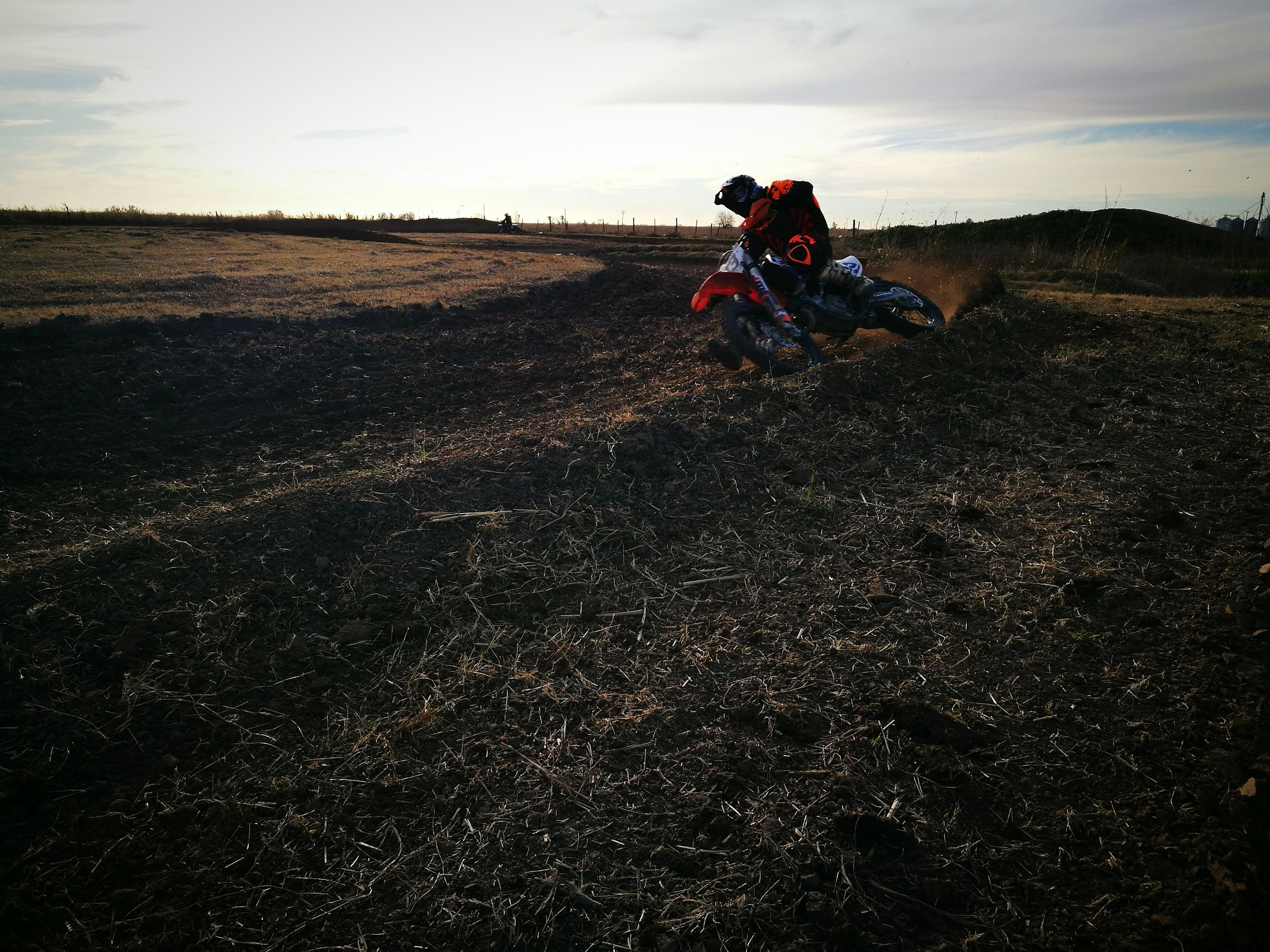 field, riding, landscape, real people, transportation, sky, motocross, one person, motorcycle, domestic animals, men, helmet, land vehicle, nature, outdoors, adventure, rural scene, lifestyles, day, mammal, sports race, people