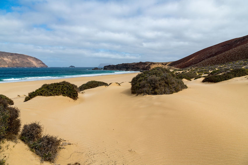 Beach at La Graciosa La Graciosa Beach Beauty In Nature Cloud - Sky Day Landscape Mountain Nature No People Outdoors Sand Sand Dune Scenics Sea Sky Tranquil Scene Tranquility Water