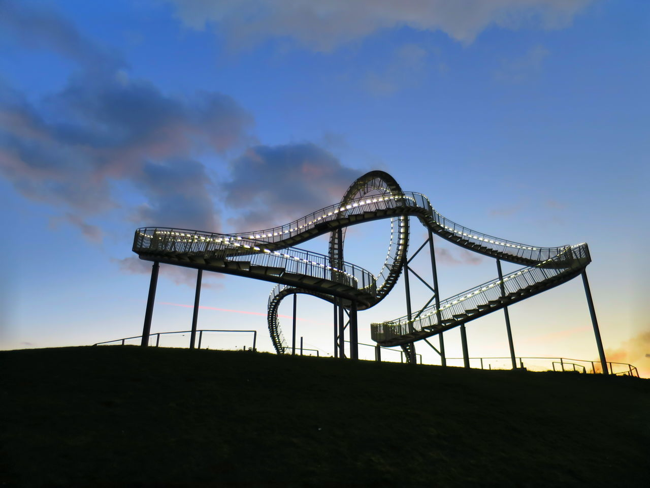 Low Angle View Of Illuminated Tiger And Turtle Against Sky