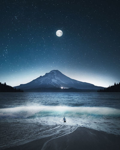 Night Wave Night Nightphotography Water Sky Beauty In Nature Mountain Scenics - Nature Nature Tranquility One Person EyeEm Best Shots EyeEmNewHere EyeEm Selects EyeEm Gallery Real People Outdoors Tranquil Scene Moon Land Sea Mountain Range Wave Waves, Ocean, Nature Stars
