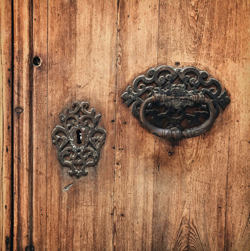 Wood - Material Door Entrance Door Knocker Metal Close-up No People Safety Closed Knob Protection Security Old Doorknob Antique Wood Craft Handle Black Color Ornate Vintage Keyhole Antique Classic Rustic Style