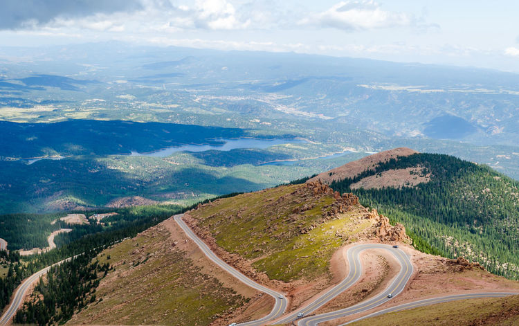 Colorado Pikes Peak Highway Pikes Peak In Colorado Road Drive Rocky Mountains USA Tourist Attraction  Cloud And Sun Places To Visit In Colorado Top View Shot Tourism Tourist Destination