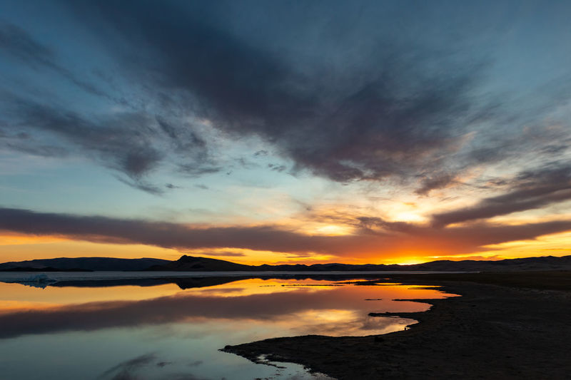 Mongolia Cloud - Sky Sky Sunset Scenics - Nature Beauty In Nature Tranquil Scene Tranquility Water Idyllic No People Nature Orange Color Non-urban Scene Sea Silhouette Dramatic Sky Reflection The Traveler - 2019 EyeEm Awards