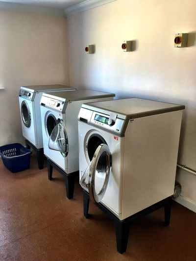 Laundry Room Washing Machines Cleaning Washing Clothes Laundering Colour Image Nobody Indoors  Vertical