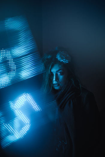Adult Beautiful Woman Contemplation Dark Data Digital Composite Futuristic Glowing Hairstyle Headshot Illuminated Indoors  Light - Natural Phenomenon One Person Portrait Projection Studio Shot Technology Women Young Adult Young Women