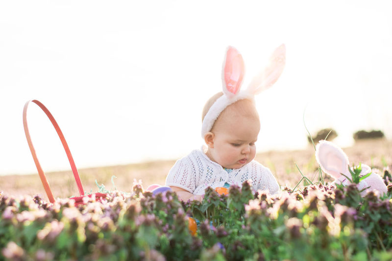 Happy Easter! Easter Easter Bunny Flower Nature Plant Springtime One Person Baby Uncultivated Enjoyment Cute Looking Down Field Growth Smiling People Beauty In Nature Grass Day Outdoors EyeEm Gallery Girl Sunset High Key Flash Photography