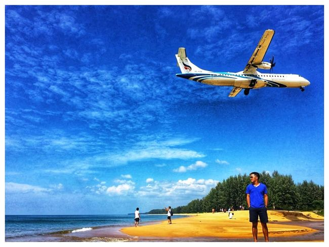Flying Sky One Man Only Mid Adult One Person Day Only Men Men Sea Blue Outdoors Airplane Watching Vacations Mid-air Beach Full Length