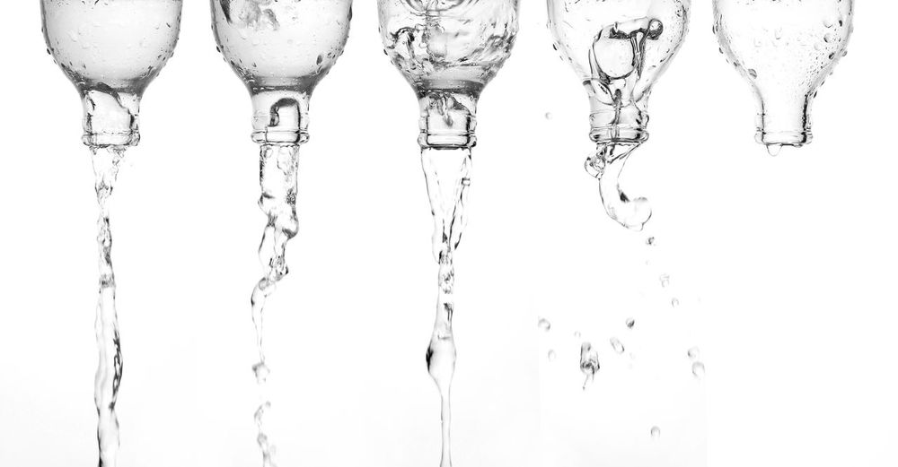 Close-up of water drops on white background