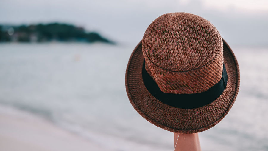 Close-up of hat on beach