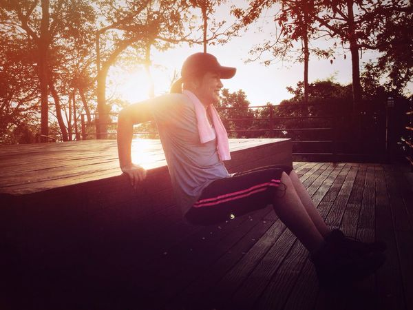 Morning Workout Sitting Full Length Sunlight Back Lit One Person Adults Only People Adult Day Young Adult Tree One Woman Only Playing Outdoors Only Women Exercise Workout Sport Woman Sport Wear Plant Silhouette