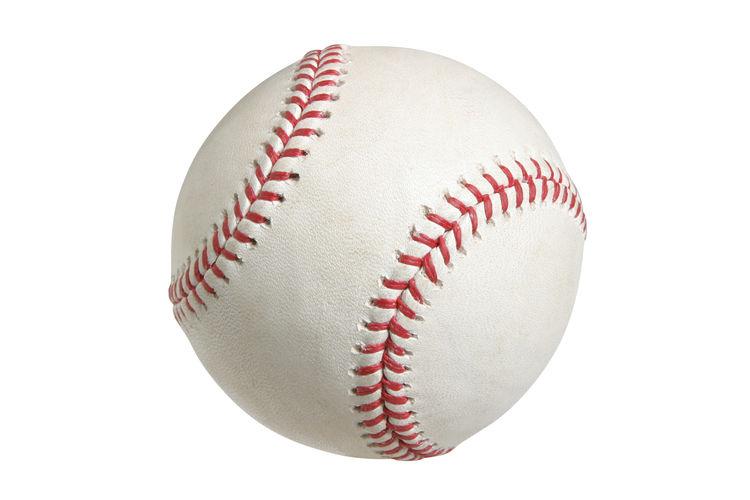 Close-up of baseball ball against white background