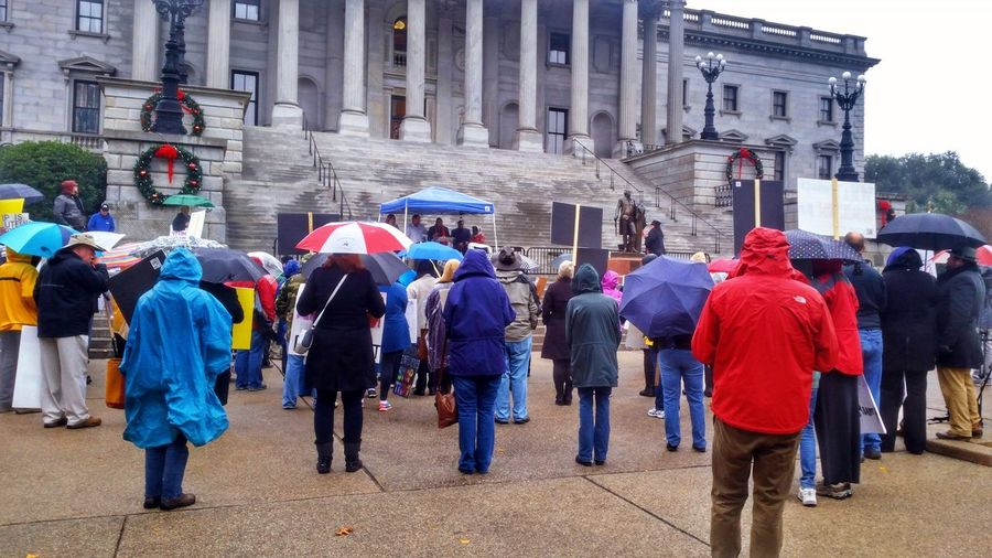 Anti-Trump Rally at the State House 12/19/16 (in HDR, 4/14) -- see the non-hdr version of this, as well as the 5th photo in the series here: @simplepoetography. Hdr_Collection Hdr Edit Protest Protesters Protesting Rally People Real People Large Group Of People Rear View Building Exterior Architecture Outdoors City Built Structure Autumn Gloomy Weather Gloomy Day Umbrellas December Photojournalism Urban Geometry Urban Buildings