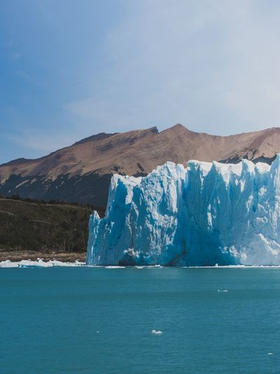 The wall Travel Iceberg Argentina Glacier EyeEm Selects Water Mountain Scenics - Nature Blue Sky Sea Beauty In Nature Tranquil Scene Nature Environment Mountain Range No People Cold Temperature Non-urban Scene Waterfront Landscape Idyllic Tranquility Day Ice