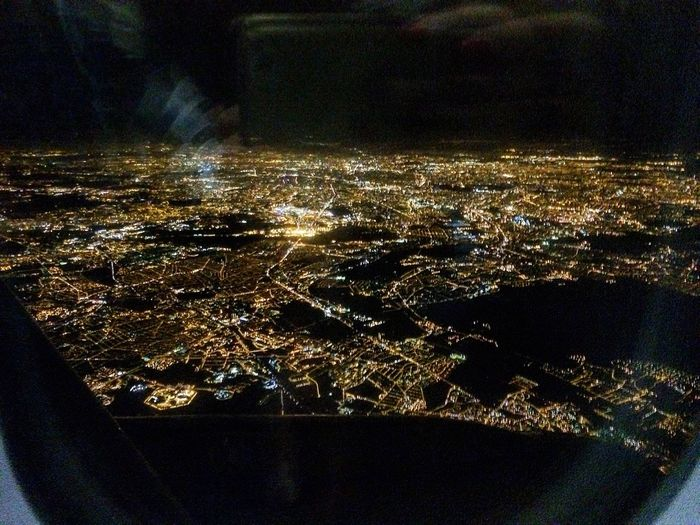 Paris Airplane Window Flying Night Travel City Lights 13th November, the terrorist attacks was happening when this photo was taken