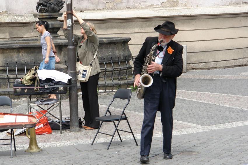 Prague. Street musician. Prague Artist Arts Culture And Entertainment City Day Mature Adult Mature Men Men Music Musical Instrument Outdoors People Performance Real People Street Musician
