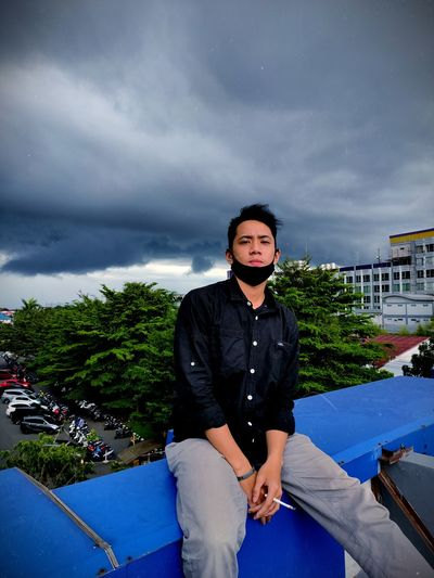 Cloudy sky a cigarette and a longing
