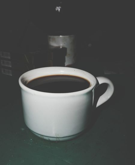 High angle view of coffee cup on table