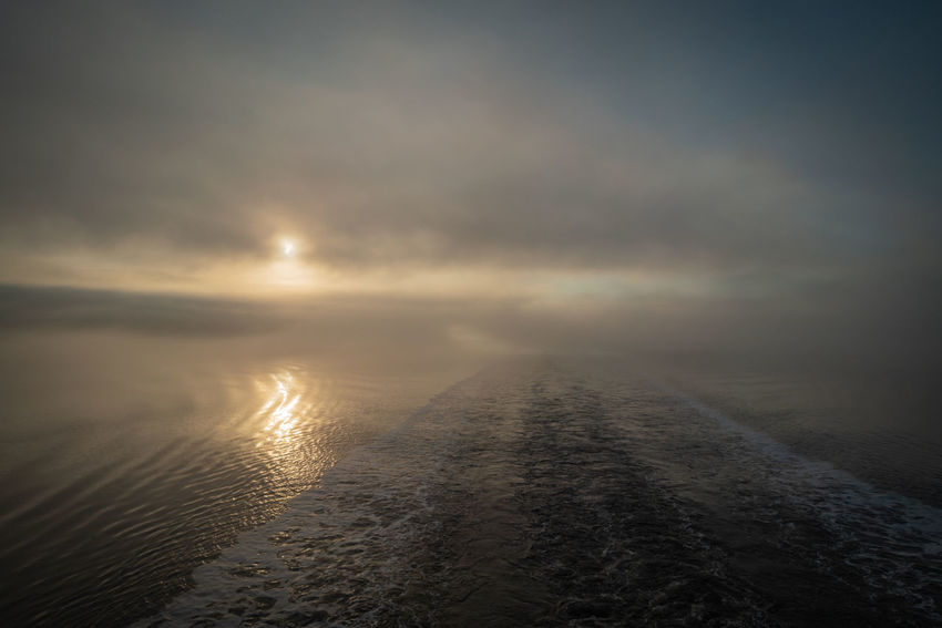 The EyeEm Collection Morning Beauty In Nature Cloud - Sky Environment Fiord Fjord Fog Foggy Foggy Morning Horizon Land Mountain Nature No People Outdoors Reflection Scenics - Nature Sea Ship Sky Sun Sunset Tranquil Scene Tranquility Water My Best Travel Photo