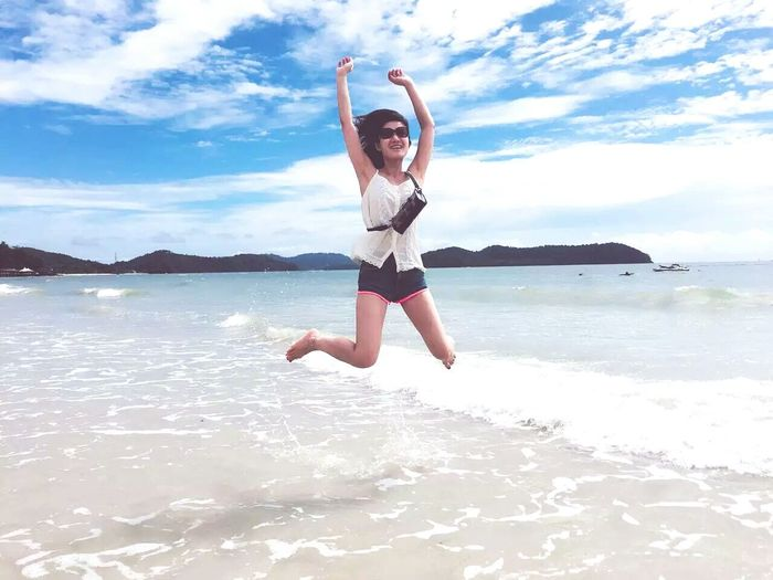 Jumping One Young Woman Only Water Motion Sky Happiness Enjoyment Freedom Beach Time