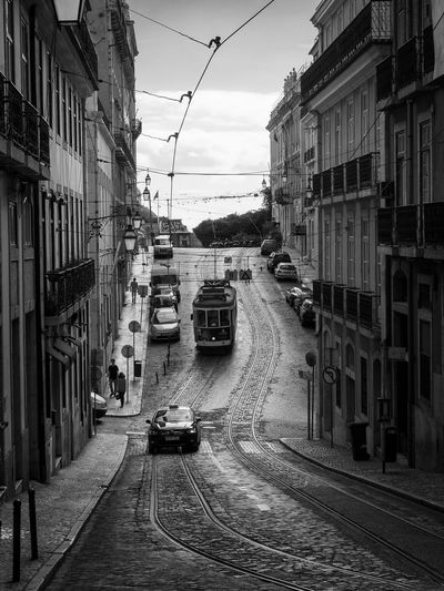 Classic cable car in Lisbon, Portugal Transportation Mode Of Transportation Building Exterior Architecture City Built Structure Car Land Vehicle Motor Vehicle Street Road Sky Building on the move Direction Residential District Nature The Way Forward Cable Car Railroad Track Track No People Outdoors Tram Europe Lisbon Vacations City Cityscape