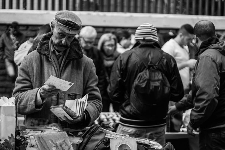 Best Seller In Porta Porte Black And White Blackandwhite Photography Human Representation Large Group Of People Medium Group Of People Men Street Photography Working Station