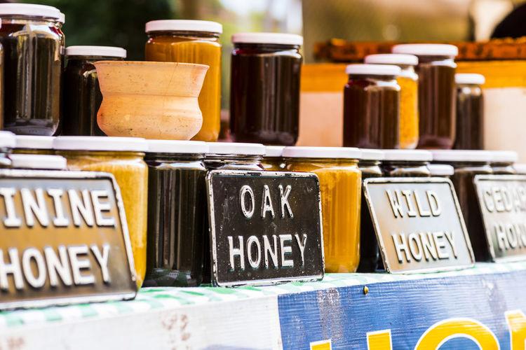 Information sign by honey jars in market