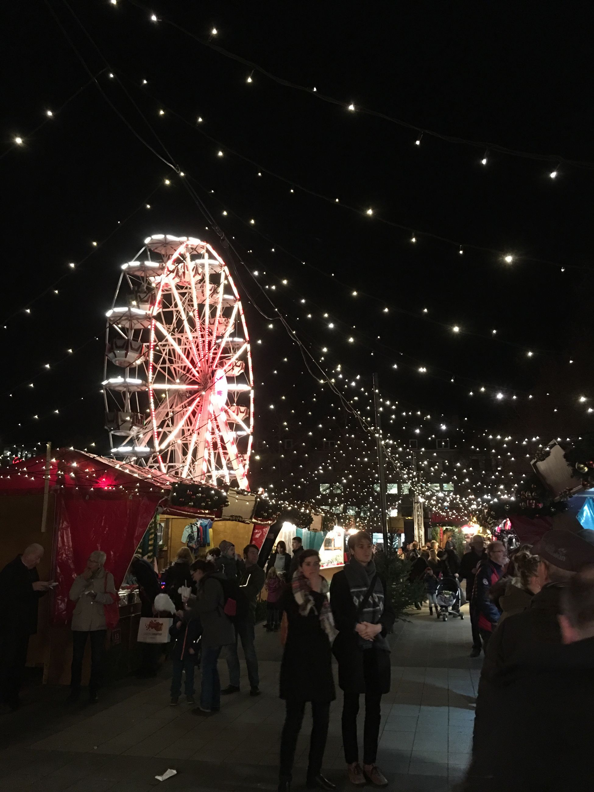 night, illuminated, ferris wheel, sky, firework display, people, celebration, motion, large group of people, firework - man made object, outdoors, midnight, adult