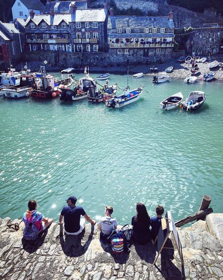 Large Group Of People Water Nautical Vessel Sitting Building Exterior Boats Harbour Sea Summer Sunshine Relaxing Tourist Architecture Outdoors Transportation Day Travel Destinations Built Structure Family Harbourside Sailing Shimmer Real People Adult People