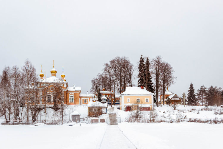 Vazheozersky Spaso-Preobrazhensky men's monastery Amazing Architecture Beautiful Church Cold Temperature Karelia Monastery Nature No People Religion Russia Snow Snowing Tourism Tranquil Scene Tree View Winter зима карелия красота монастырь Россия Церковь The Architect - 2017 EyeEm Awards