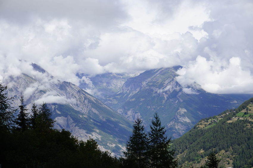 Clouds in the mountains. 4vallees Valais Beauty In Nature Cloud - Sky Mountain Nature No People Non-urban Scene Outdoors Plant Scenics - Nature Sky Switzerland Tranquil Scene Tranquility Tree