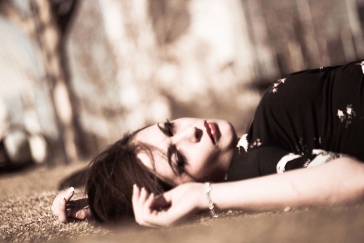 Close-up of young woman lying down