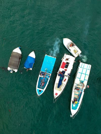 Tanjung Benoa Boats. Nusa Dua  Tanjung Benoa ASIA INDONESIA Bali Exhaust Fumes Exhaust Gases Exhaust Birds Eye View Bright Colors Dji Indonesia Drone Photography Bali Drone Photography Boats Pollution Smoke Pollution Speed Boats Small Boats Boat Boats And Sea Boats On Water Boats And Moorings Boats And Water High Angle View Nautical Vessel Transportation Water Mode Of Transport Day Outdoors EyeEm Ready   EyeEmNewHere Visual Creativity