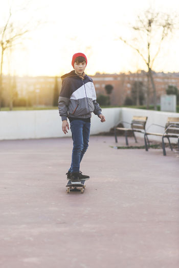 Fun Hat Jeans Skateboarding Childhood Day Enjoyment Extreme Sports Full Length Leisure Activity Lifestyles One Person Outdoor Outdoor Photography Outdoors Portrait Real People Ride Skate Smiling Sport Sunset Teen Teenager Young Adult