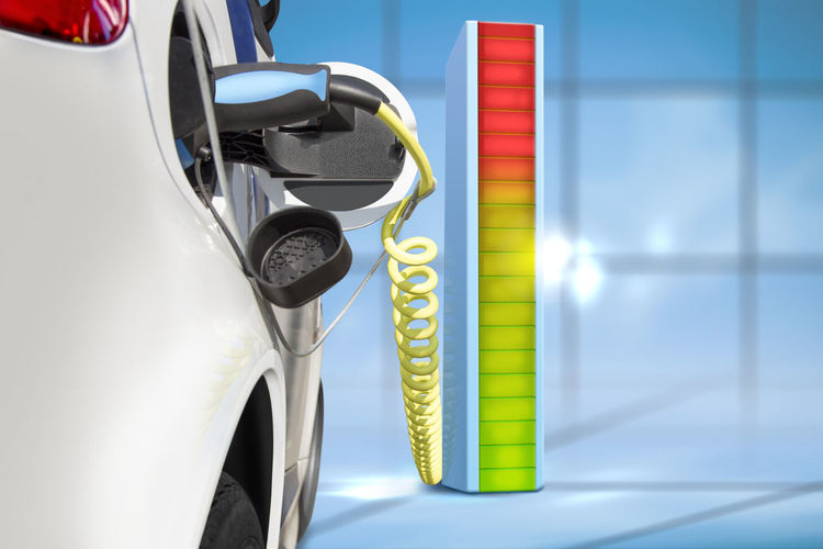 Digital composite image of car charging with battery