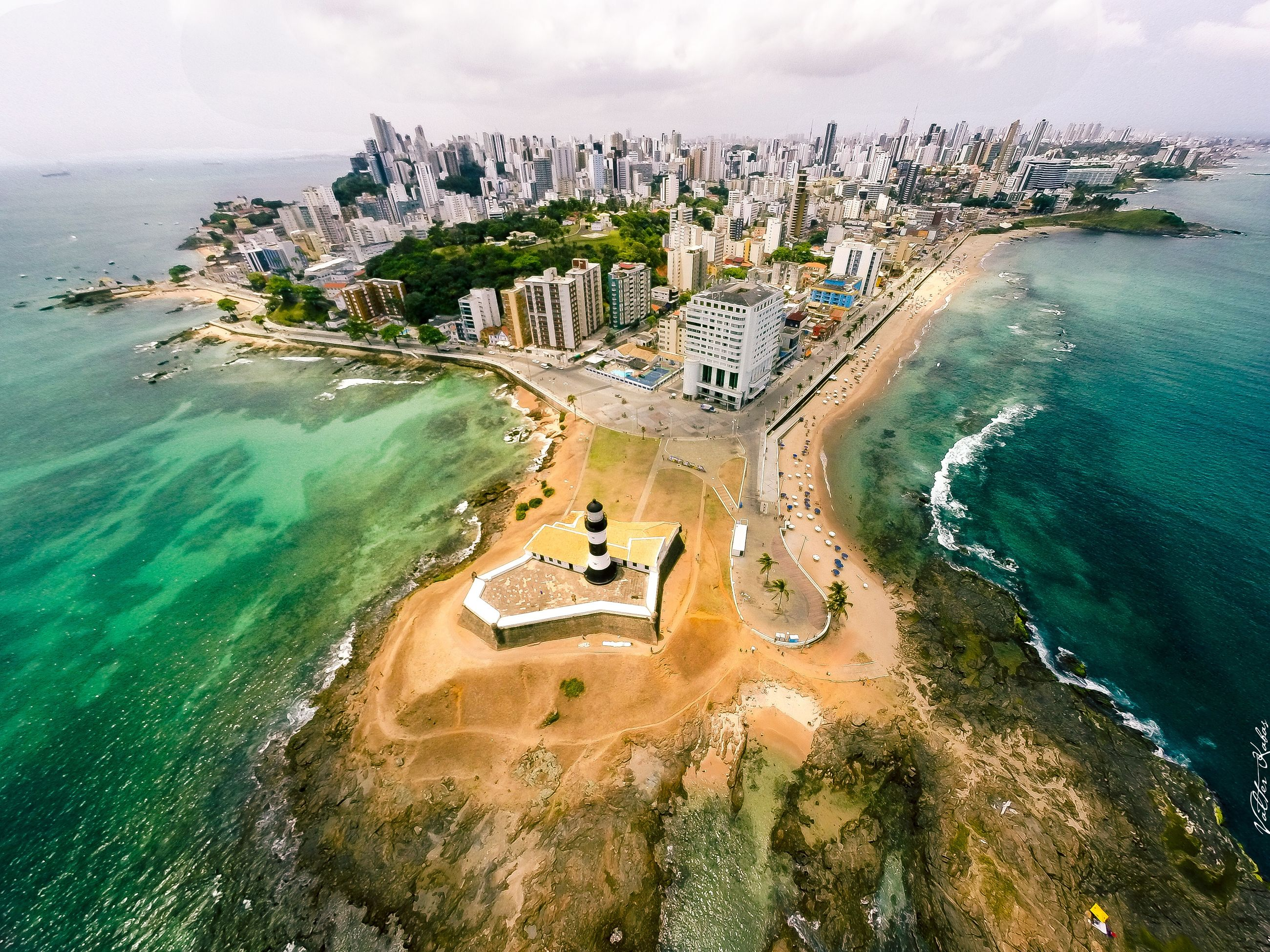 sea, water, high angle view, architecture, building exterior, built structure, cityscape, coastline, aerial view, horizon over water, beach, city, scenics, sky, travel destinations, nature, travel, beauty in nature, tourism, crowded