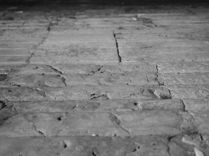 Old stone steps at the shore of Cais das Colunas in Lisbon, Portugal. Cais Das Colunas Pattern Pieces Portugal Stairs Backgrounds Black And White Blackandwhite Bw Cais Das Colunas Lisboa Close-up Cracked Damaged Full Frame Lisbon Night No People Old Pattern Selective Focus Shore Steps And Staircases Stone Stone Material Street Textured